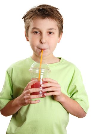 A child drinking a fresh berry juice packed full of vitamins and healthy nutrition. photo