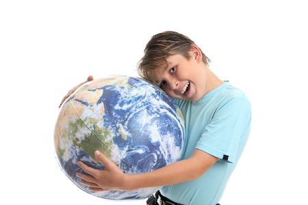 A young boy with his hands hugging the world earth ball.  He is leaning his head into the earth affectionately and smiling.  Concept environmental protection, world care, travel eco-tourism, etc photo