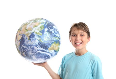 A smiling, cheerful boy student holding the world earth in the palm of his hand. photo