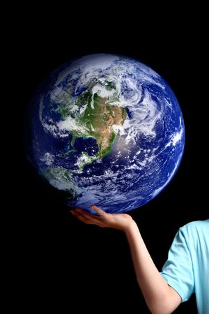A person holds balances the earth in the palm of his hand.  Set against a dark background, concept for environment issues, global issues,travel, geopolitical, save the planet, etc.   Or replace the earth with your own object Stock Photo - 5997422