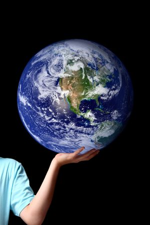 The whole earth is my birthplace and all humans are my brothers.... Kahil Gibran.  A person holds balances the earth in the palm of his hand.  Set against a dark background, concept for world peace, environment issues, global issues, travel, save the plan Stock Photo - 6139548