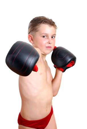 Boy boxer wearing gloves, throws a punch photo