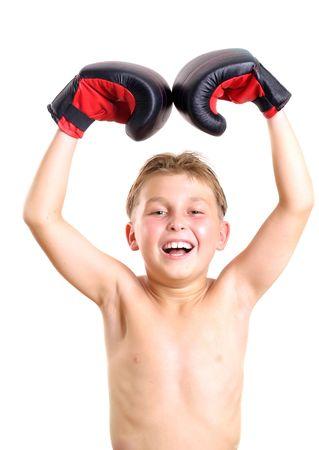 boxing boy: Child celebrates boxing victory