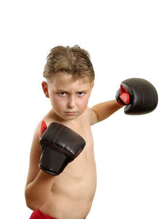 Boy in boxing gloves throwing some punches. photo