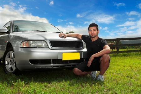 sedan: A man beside the bonnet of car in the afternoon sun in rural Australia.  Fill flash to mans face.