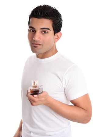 A man holds a bottle of cologne, aftershave or men's fragrance in his hand Stock Photo - 6511172
