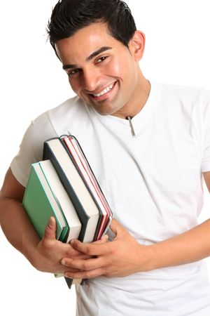 Cheerful friendly male university or college student carrying study books.