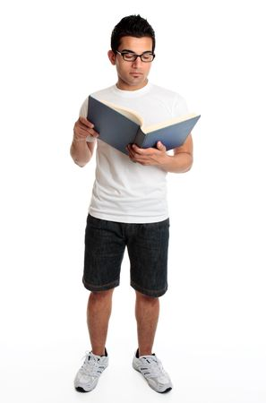 A man reads from a hardcover book Stock fotó