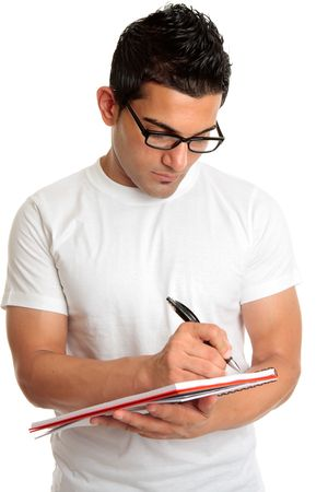 A male college or university student wearing glasses, writing in a lecture notepad. Stock Photo - 6544781