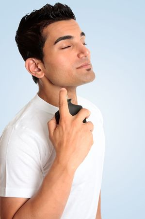 eau: A male spraying perfume cologne fragrance to his neck area.