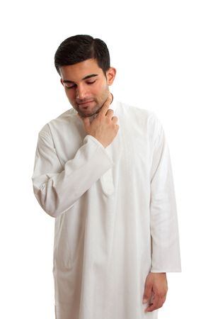 thoub: Middle eastern man wearing a traditional Kurta, thoub, thobe, thawb, dishdash, kaftan etc.  They are often loose fitting and made of cool cotton due to the hot climates.   This one has elegant embroidery throughout. Stock Photo