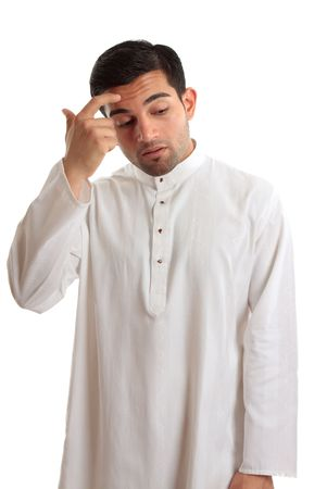 Middle eastern ethnic man wearing a robe, kurta, dishdash, thoub, etc held together with ruby inset buttons.  He is scratching forehead and pondering an issue or contemplating a decision photo