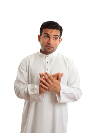 thoub: An arab businessman wearing traditional clothing, looking worried or concerned and looking up