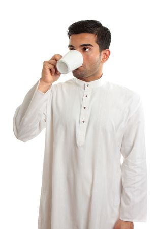 thoub: An arab middle eastern man drinking coffee.   Arabica coffee is indigenous to the mountains of Yemen.  The Arab innovation in Yemen of making a brew from roasted beans, spread first among Egyptians and Turks and later spread around the world. Stock Photo