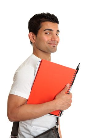Happy smiling university or college student holding book and pen Stock fotó