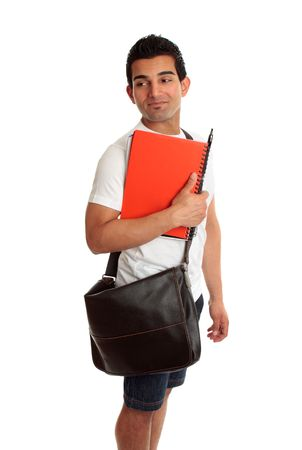 Male student carrying books,  looks over his shoulder. Suitable for your message. photo