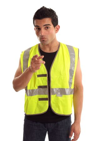A construction worker, repairman, tradesman wearing safety vest is pointing his finger. Stock Photo - 6803350