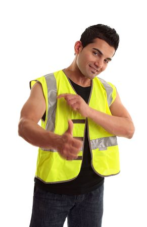 Cool young tradesman, construction worker or handyman gesturing thumbs up, approval, great job, success, etc.  Motion in hands photo