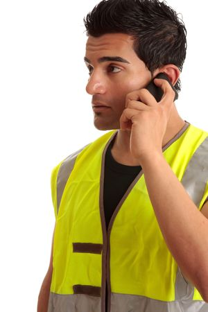 Male tradesman, handyman, builder or other labourer occupation is talking on a mobile phone. Stock Photo - 6803352