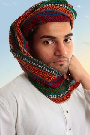 thoub: An adult arab middle eastern man dressed in traditional clothing.  He has a keffiyeh turban on his head. Stock Photo