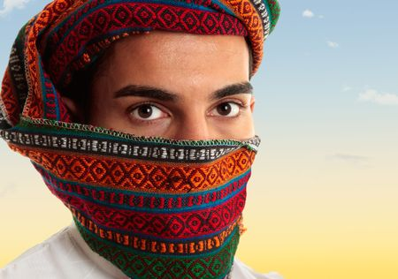 bedouin: An arab middle eastern man wearing a coloured omani royal keffiyeh which can also be worn like a turban Stock Photo