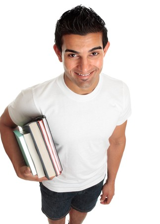 Happy male ethnic mixed race student looking up and smiling.  He is carrying books under one arm.  White background. Stock Photo - 7072025