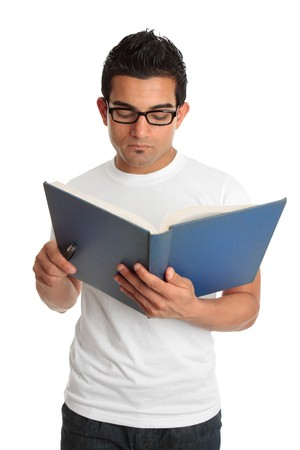 italian ethnicity: Young adult man reading a book.   He is wearing glasses.  White background.