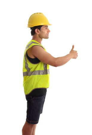 A construction worker, builder or other handyman or tradesman giving a thumbs up gesture.  White background. photo