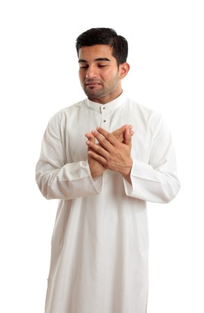 kameez: A worried,troubled, stressed or sad ethnic middle eastern or arab man in traditional  white robe.  White background.