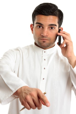thoub: An arab middle eastern ethnic man pointing his finger.  He is wearing a traditional white robe eg kurta dishdasha.  White background.
