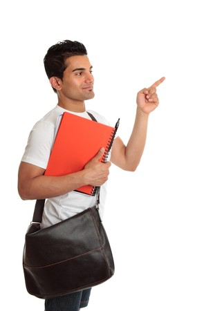 A smiling student with satchel and notebook, looking and pointing to your message.  White background. photo