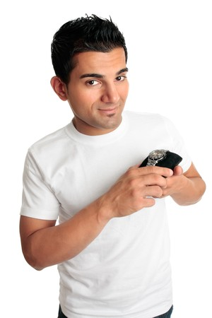 A smiling ethnic man holding or showing a chronograph watch.   White background. photo