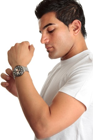 A man trying on a chronography wrist watch.  White background. photo