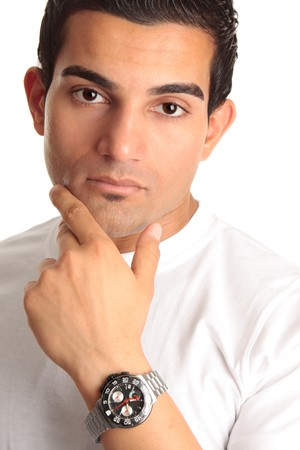 Thinking man wearing a chronograph wrist watch or man advertising a watch.  White background. photo