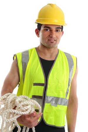 A builder, tradesman or construction worker wearing a hard hat and high visibility vest.  White Background. photo