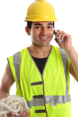 labourer: Happy smiling builder, civil engineer, construction worker, labourer using a telephone.  He is wearing yellow hard hat and reflective high visibility vest.  White background.