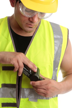 italian ethnicity: A builder construction worker holding a measuring device