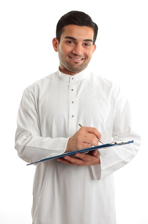 thoub: A smiling ethnic businessman writing on a clipboard folder