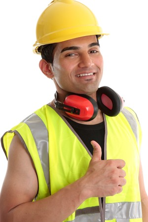 building worker: Smiling builder, construction worker or other trades man showing a  thumbs up sign. White background. Stock Photo