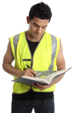 Builder or construction worker writing in a book.  White background. photo