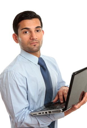 A businessman in blue pinstripe shirt holding a laptop computer.   White background.