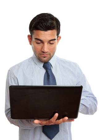 Businessman using a laptop computer.  White background. photo