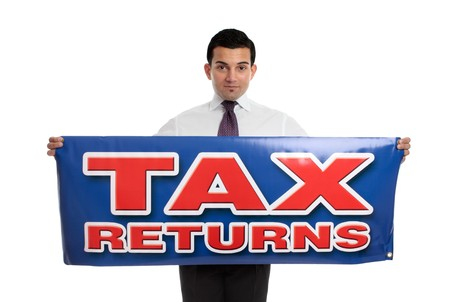 A businessman or accountant holding a tax returns sign.  Or replace with your own message.  White background. Stock Photo - 7342724