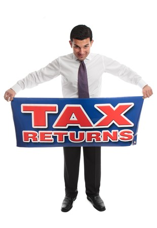 Business man, accountant or taxman standing and holding a Tax Return sign message.  Or replace with your own message.  focus to sign.  White background. Stock Photo - 7342722