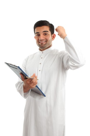qameez: A middle eastern mixed r4ace businessman with clipboard folder and hand raised in success or victory.  White background.