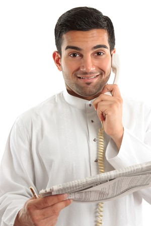 kurta: Happy businessman, accountant, banker, stockbroker, etc on the phone and holding a newspaper at the finance section. Stock Photo