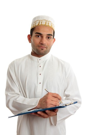 qameez: Arab mixed race business man wearing traditional middle eastern attire and topi gold embroidered hat.  He is holding a clipboard folder and writing.  White background.