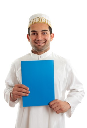 Arab italian mixed race business man holding a brochure or document.  Bohra men wear a traditional white three piece outfit, plus a white and gold cap called a topi.  White background. Stock Photo - 7362116