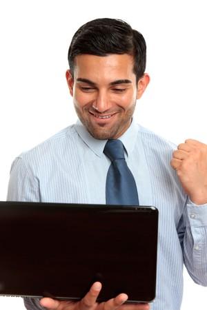 Successful businessman using laptop or internet photo