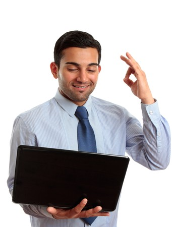 Businessman with laptop computer showing okay hand sign, approval, excellent, exceptional, recommendation, etc.  White background. photo